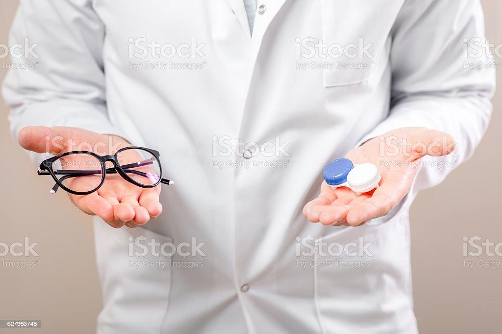Choosing between lenses and glasses stock photo