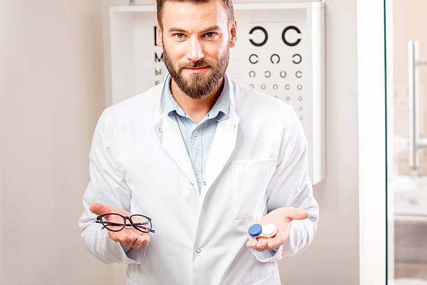 choosing between lenses and glasses - farblinsen stock-fotos und bilder