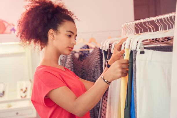 Choosing clothes african teenager girl standing choosing clothes from picture id1194177786?b=1&k=6&m=1194177786&s=612x612&w=0&h=fyzv2atgibmukhbcyrhd2pbdt3ro0qiau3twdhvdmni=