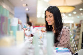 young woman shopping for make up