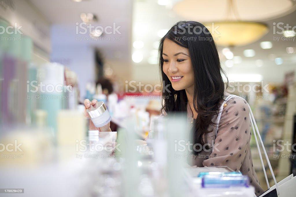 choosing cosmetics stock photo