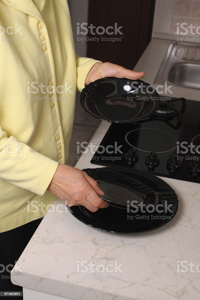 Choosing dinnner plates royalty-free stock photo