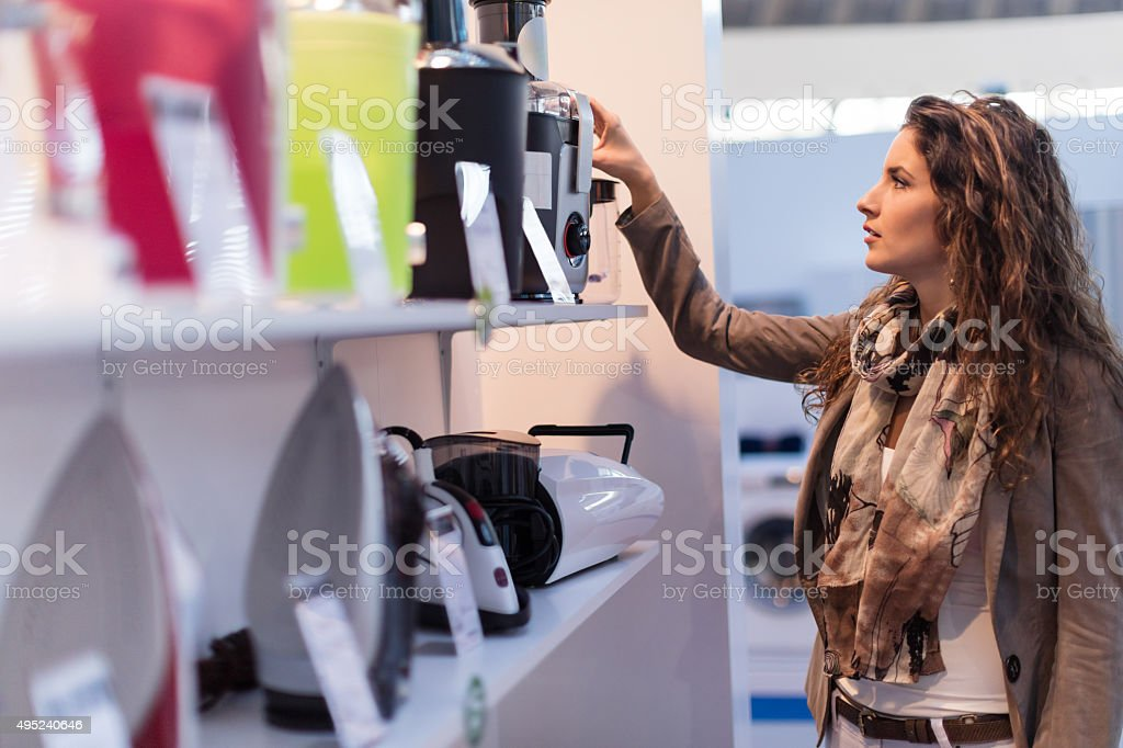 Choosing electric juicer stock photo