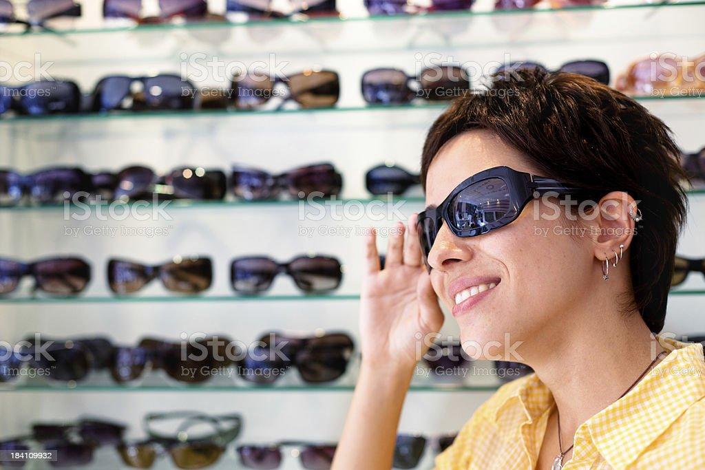 Choosing Eyeglasses royalty-free stock photo