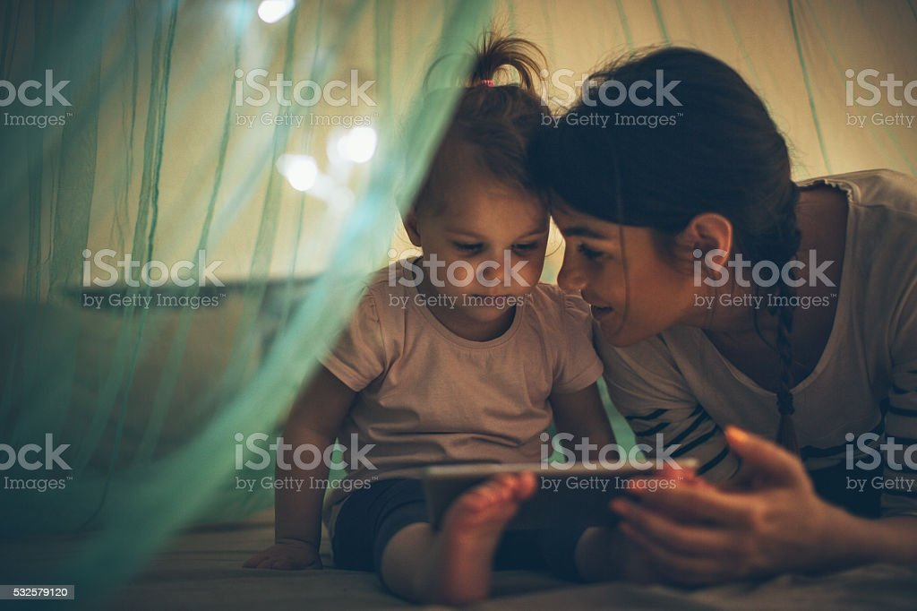 Choosing her favourite bedtime ebook stock photo
