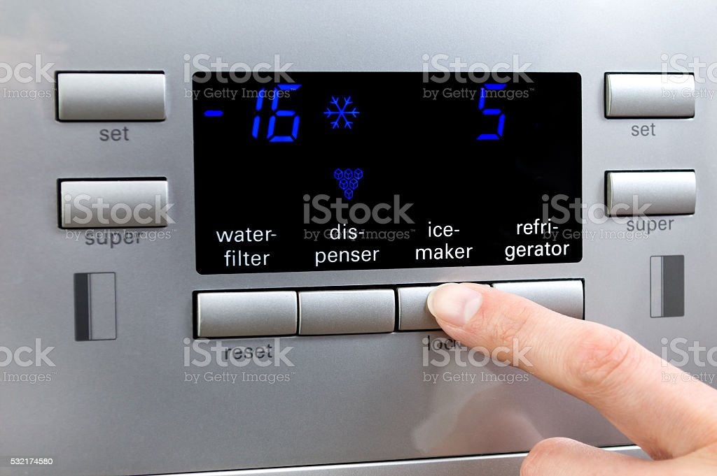 Choosing ice-maker programme at refrigerator displayer stock photo