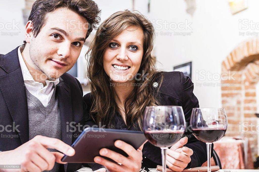 Choosing Menu from a Digital Tablet at the Restaurant stock photo