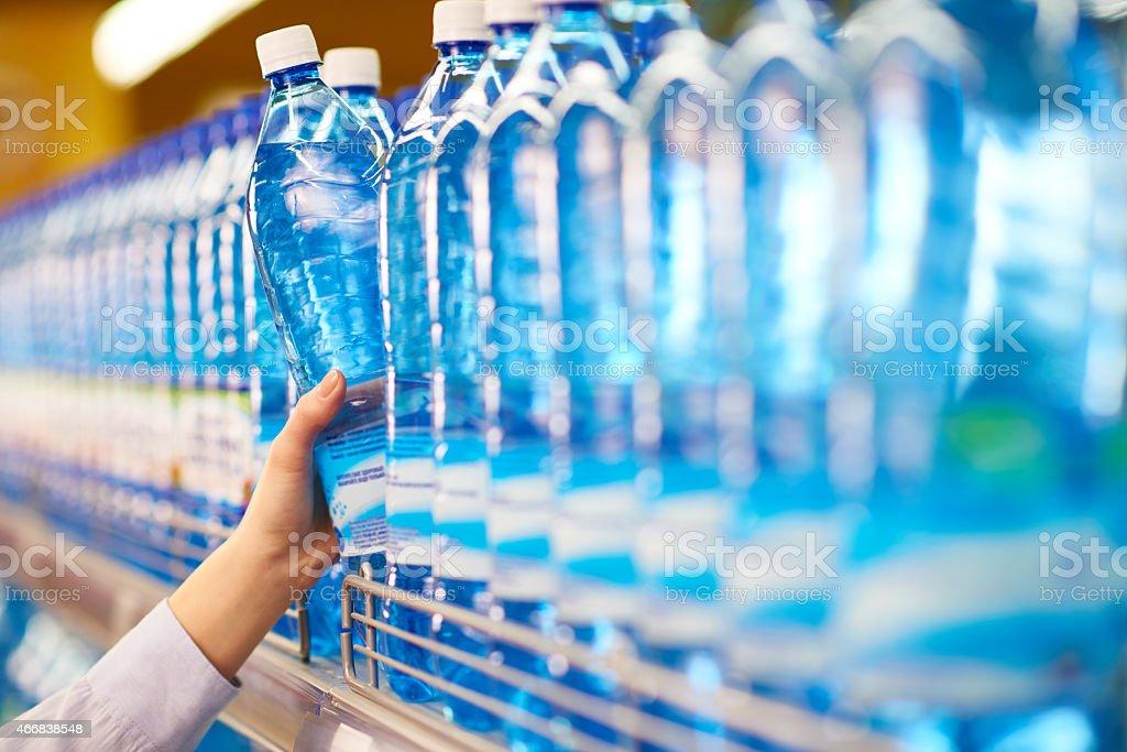 Choosing mineral water stock photo