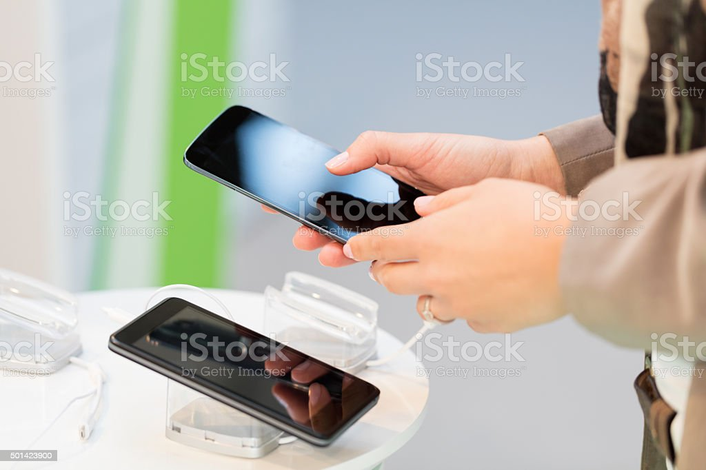 Choosing new smartphone stock photo