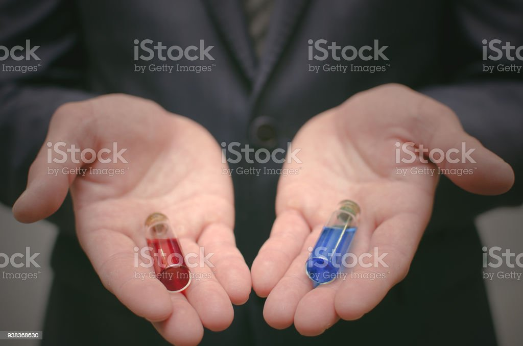 Choosing of red or blue pill concept. Right choice. Comparison of two drugs or steroids concept. stock photo