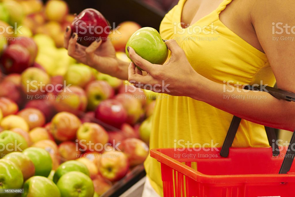 Choosing Red Or Green Apple stock photo