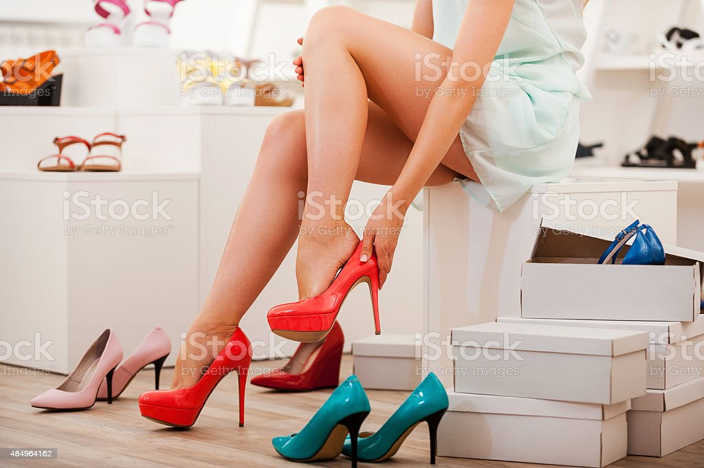 Choosing right shoes for today. stock photo