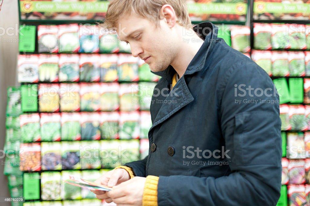 Choosing seeds stock photo