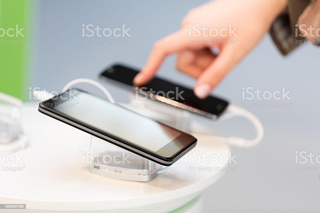 Choosing smartphone stock photo