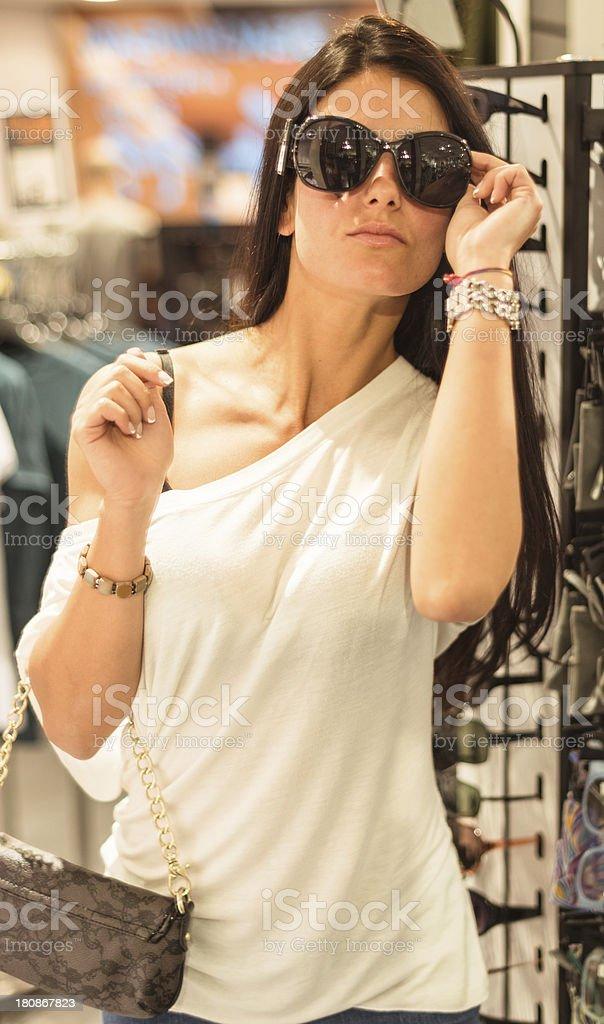 choosing sunglasses at store royalty-free stock photo