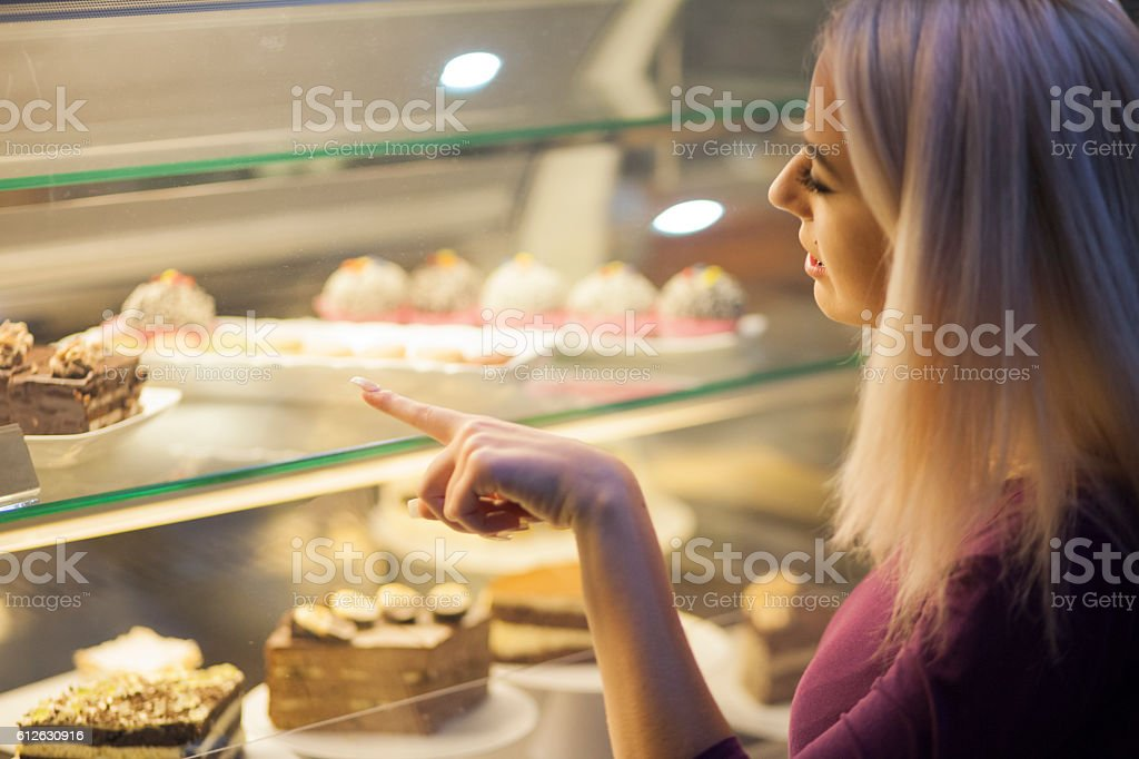 Choosing sweets in a coffee shop stock photo