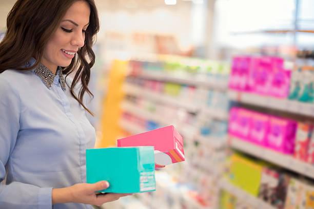 choosing tampons - drogerie stock-fotos und bilder