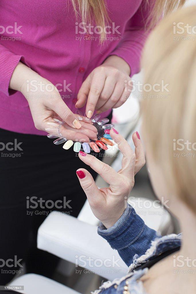 Choosing the nail polish color stock photo