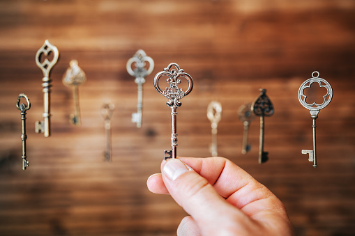 istock Choosing the right key, metaphorical to make right decisions 1197590064