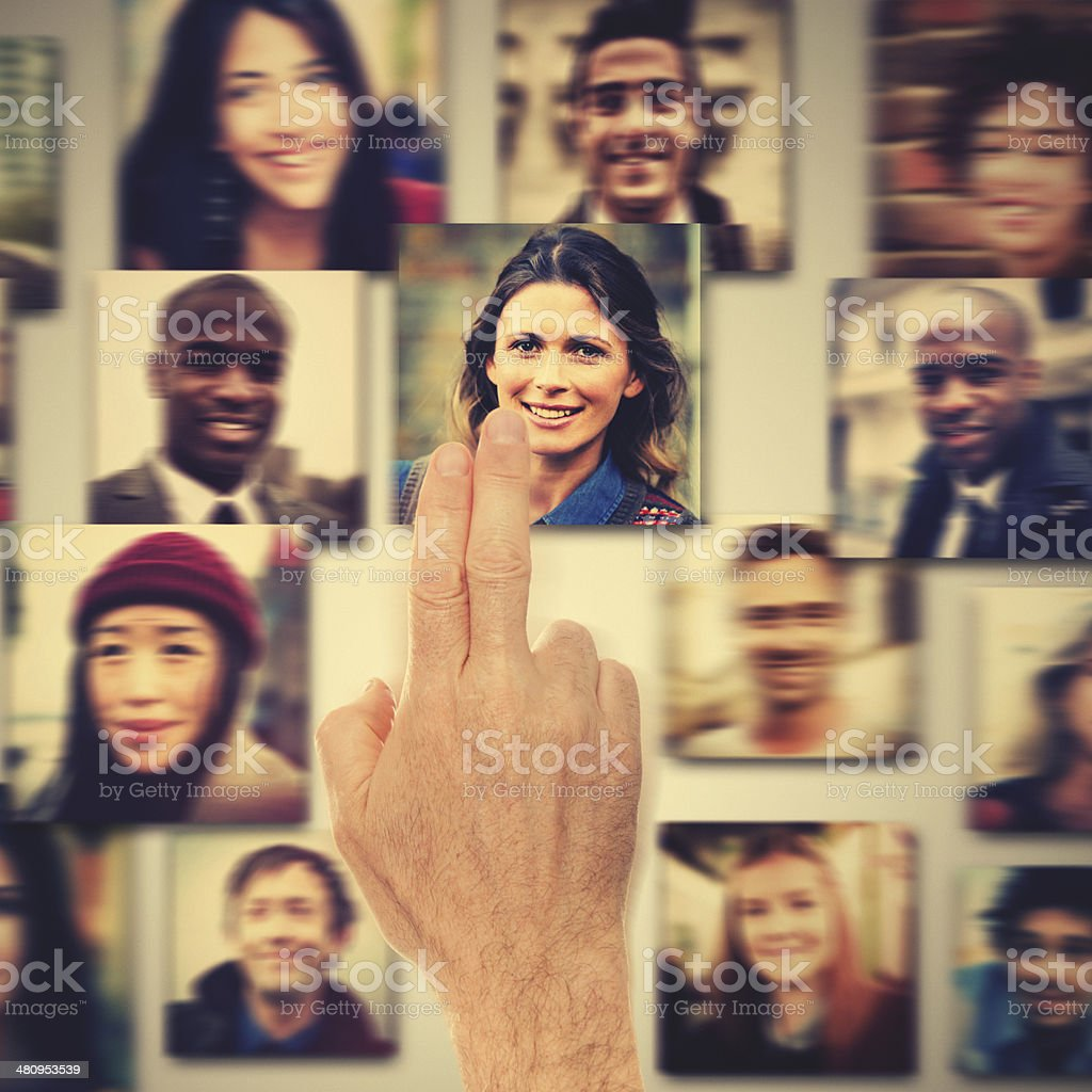 choosing the right woman candidate on touch screen royalty-free stock photo