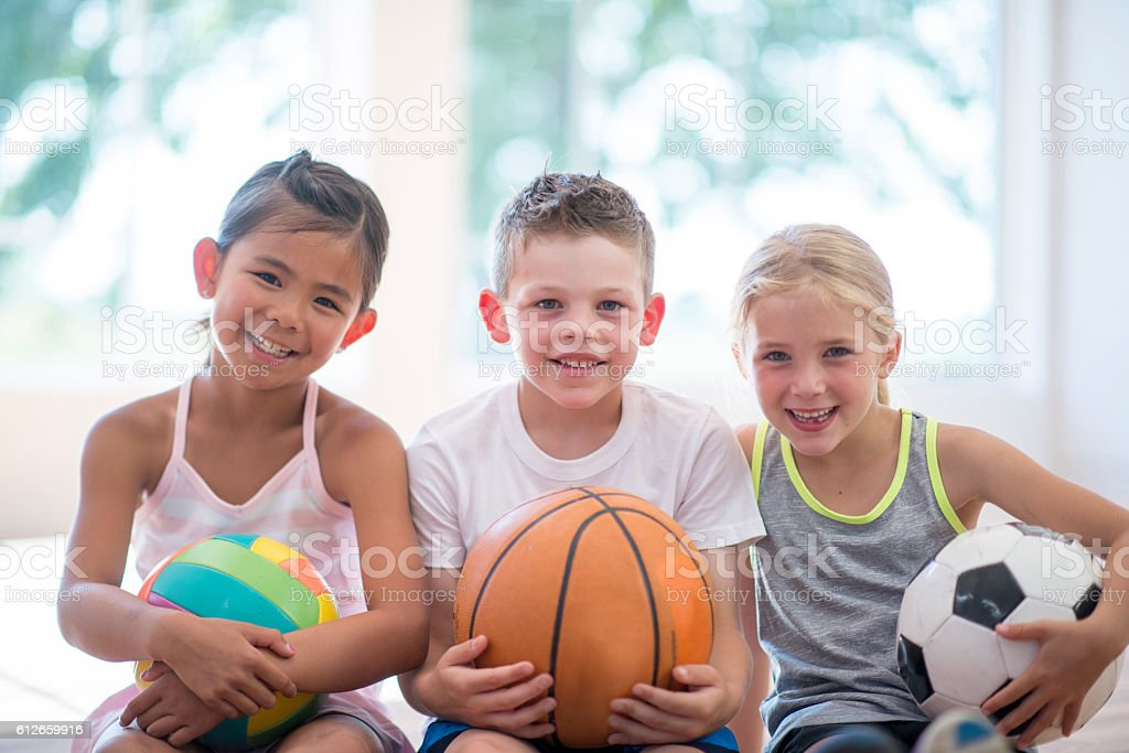 Choosing Their Favorite Sports stock photo