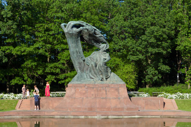 Chopin Statue in Warsaw's Royal Baths Park stock photo