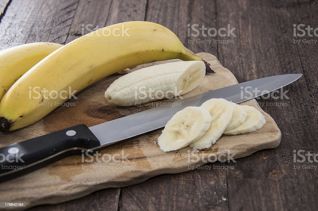 Chopped Banana on a cutting board royalty-free stock photo