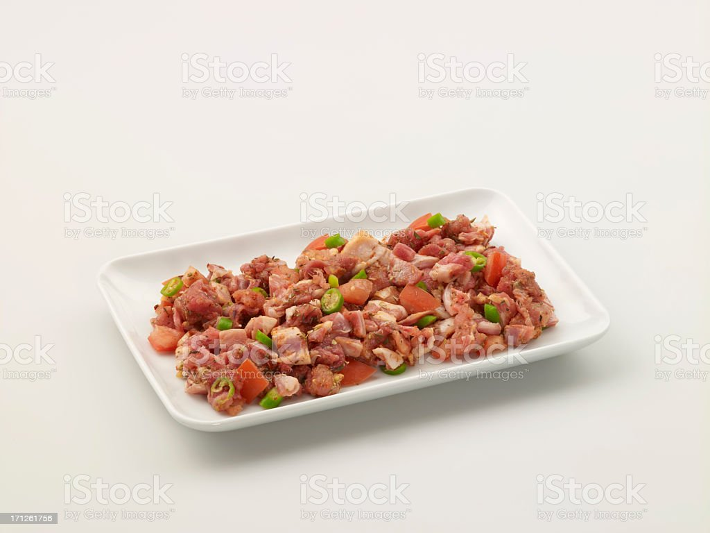 Chopped Beef With Pepper And Tomatoes In A Plate royalty-free stock photo