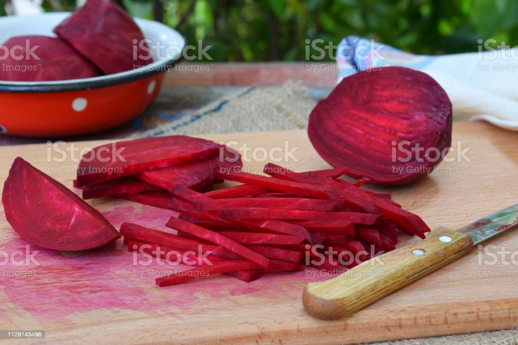 Chopped beetroot. Beet stick slice on cutting board. Preparing for cooking. Raw. Healthy food. stock photo