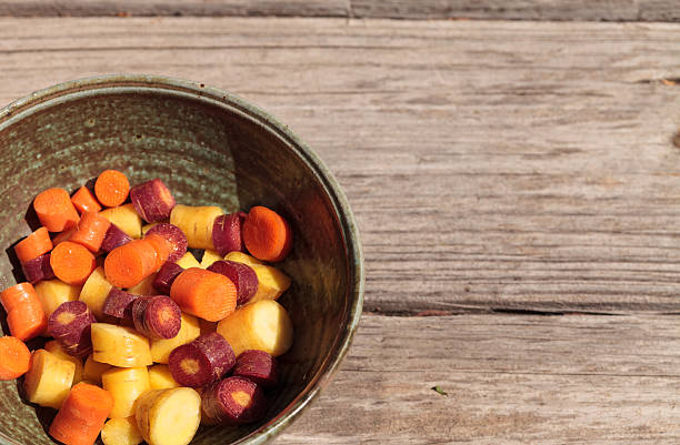 Chopped colorful red, yellow and orange organic carrots stock photo