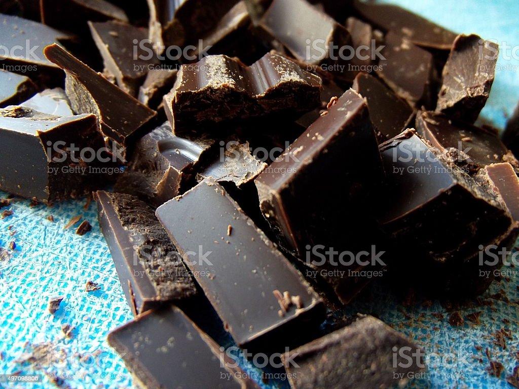 Chopped Dark Chocolate on Blue Cutting Board stock photo