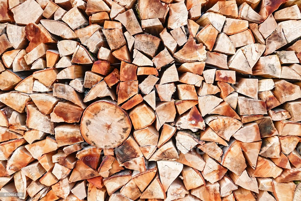 Chopped firewood in stack background texture stock photo