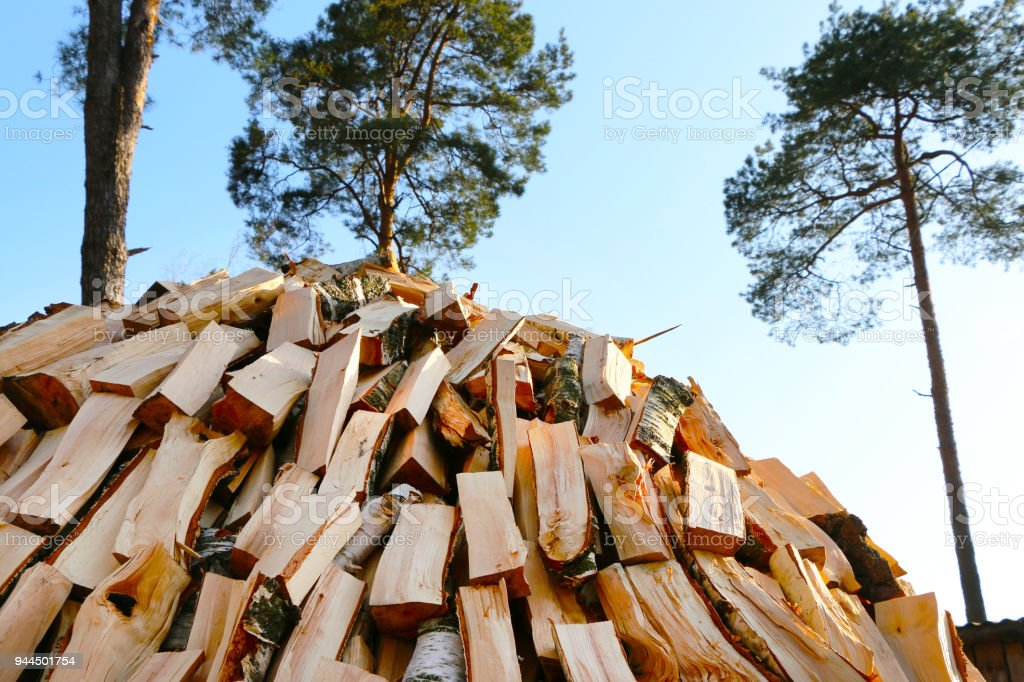 chopped firewood pile stock photo