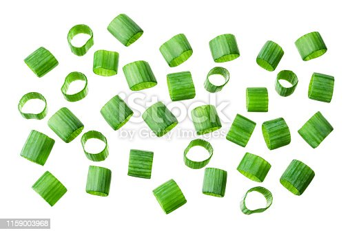 Chopped fresh green onions. Spring chopped onions. Green onion isolated. Flat lay.