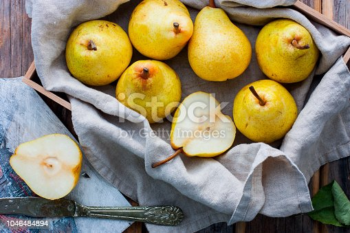 Chopped fresh yellow pear on a wooden board, top view, selective focus Fruit background.