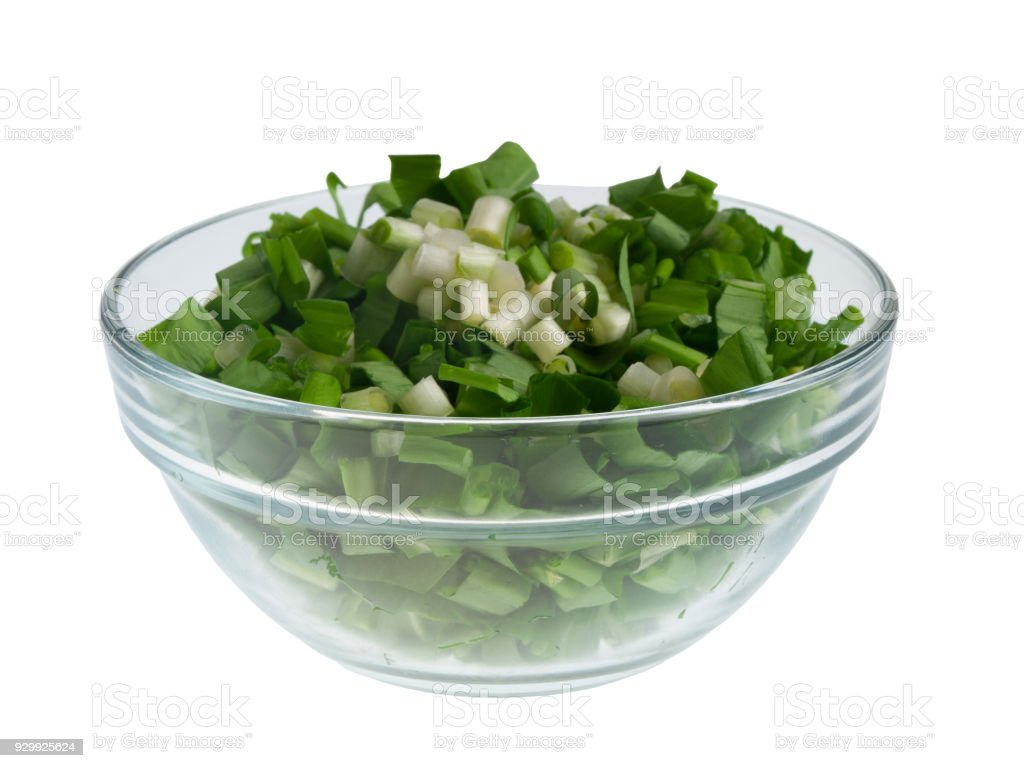 Chopped leaves of ramson in a bow stock photo