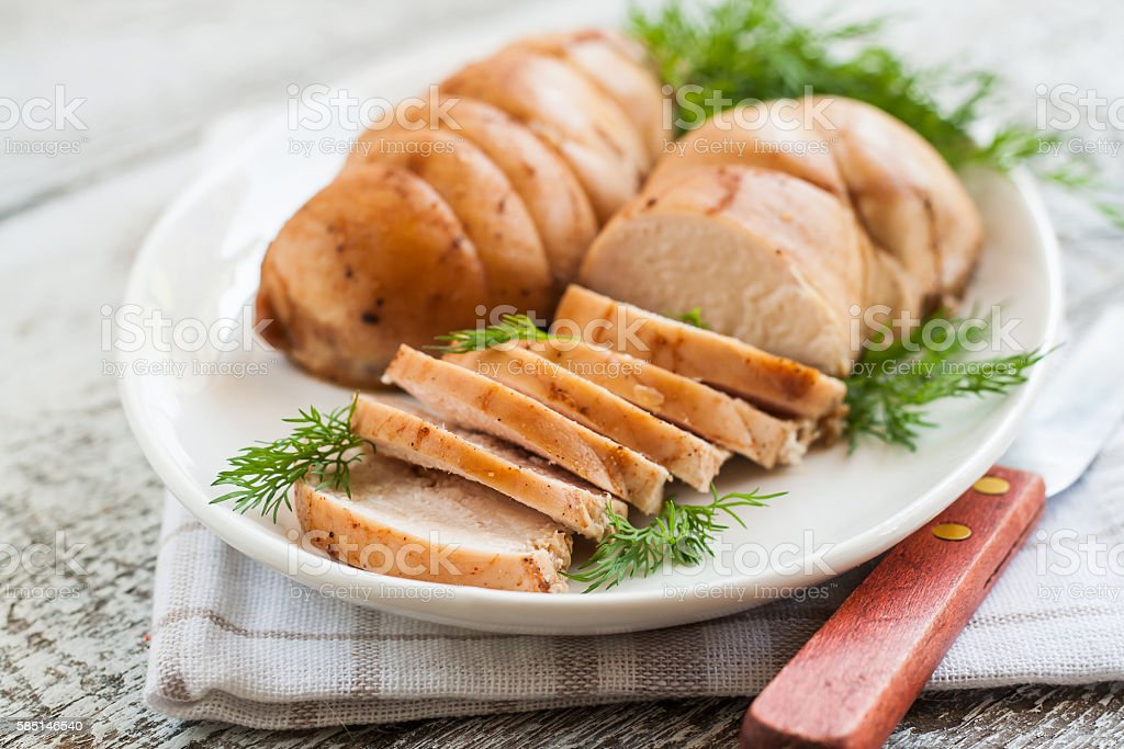 chopped meat fillet baked with herbs on a plate stock photo
