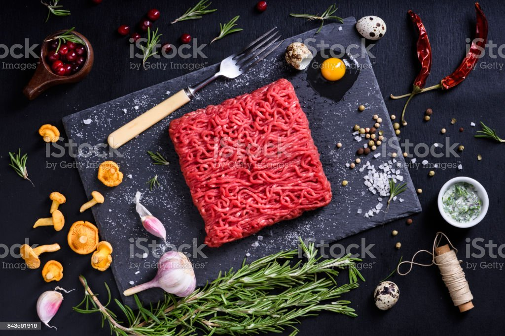 Chopped or minced meat with herbs. Restaurant cooking concept. stock photo