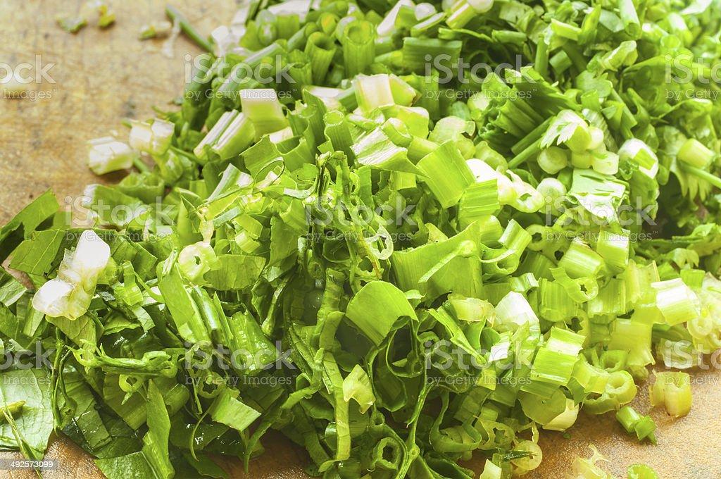 Chopped parsley on chopping board stock photo