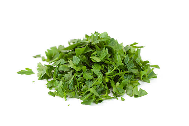 Chopped parsley chopped parsley - pieces chopped food stock pictures, royalty-free photos & images