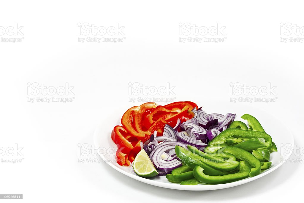 Chopped peppers and onion on a white background royalty-free stock photo