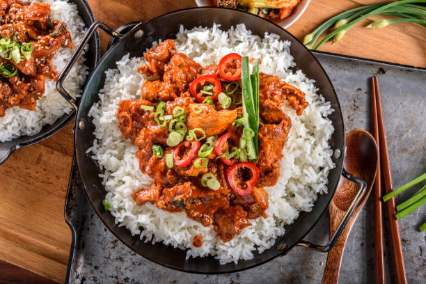 Chopped Pork Meat Cooked with Red Chili Paste, Gochujang Sauce, over Rice stock photo