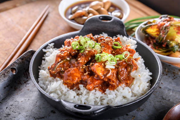 Chopped Pork Meat Cooked with Red Chili Paste, Gochujang Sauce, over Rice Pan fried Pork Meat over steamed rice asian food stock pictures, royalty-free photos & images