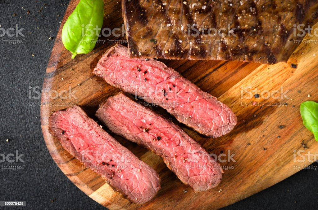 chopped rare steak pepper salt garlic basil stock photo