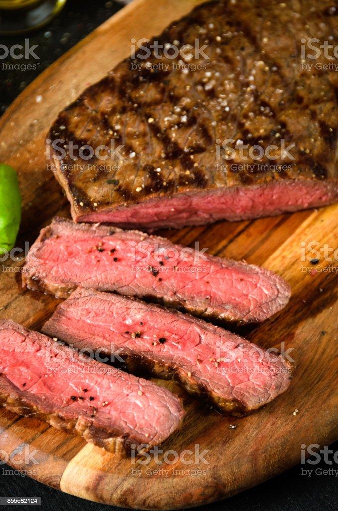 chopped rare steak pepper salt garlic knife stock photo