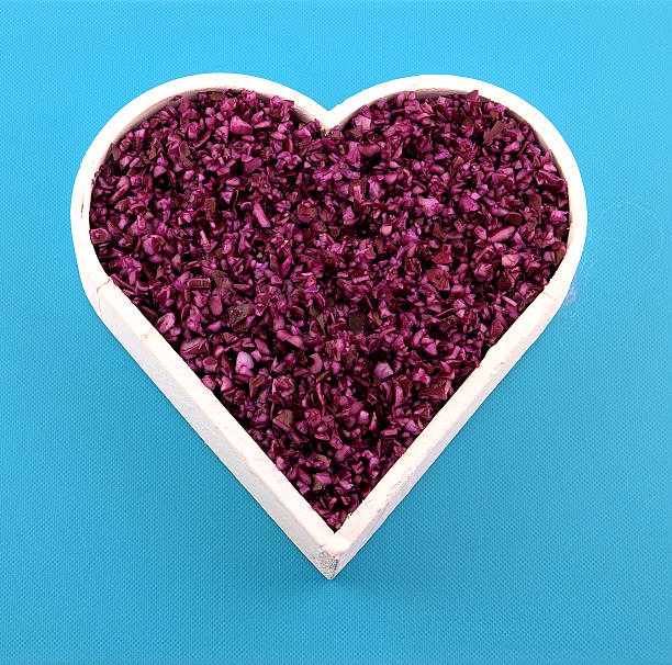 Chopped red cabbage in a heart stock photo