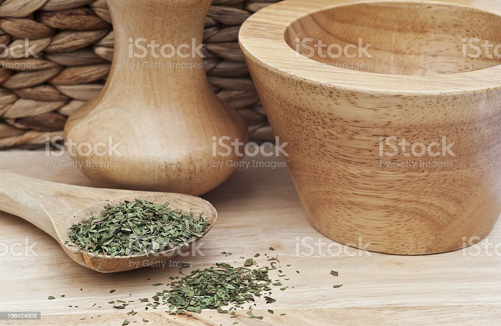 Chopped tarragon in rustic kitchen setting royalty-free stock photo