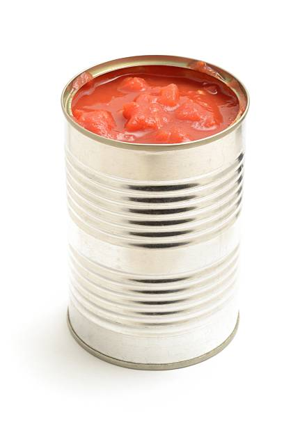 chopped tomatoes in a tin - tomato can stock photos and pictures