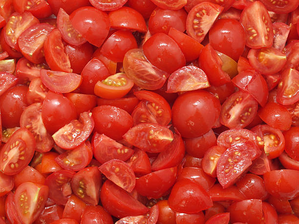 Chopped Tomatoes Close up on chopped tomatoes chopped food stock pictures, royalty-free photos & images