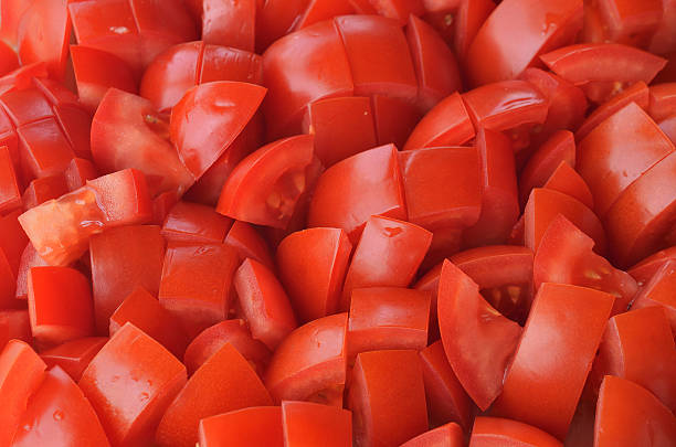 Chopped tomatoes pieces Chopped tomatoes pieces texture pattern chopped food stock pictures, royalty-free photos & images